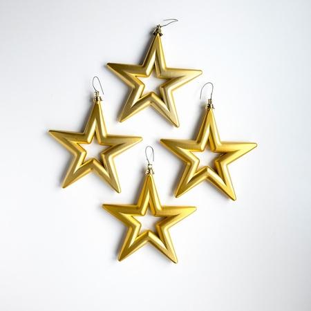 18 set a 4 st. Open Star - 14 cm Goud